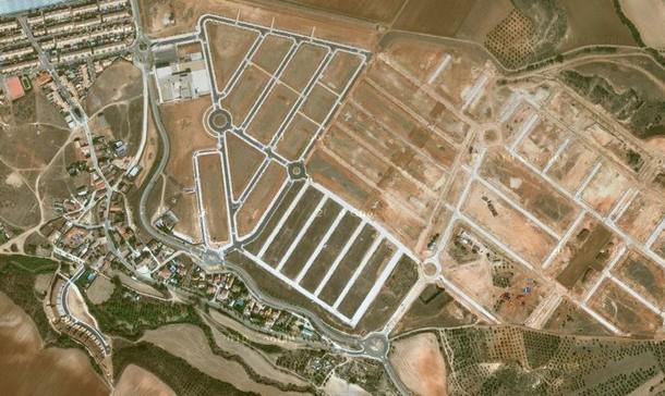 quer, na província de guadalajara: 449 moradores vivem numa àrea projectada para milhares de pessoas