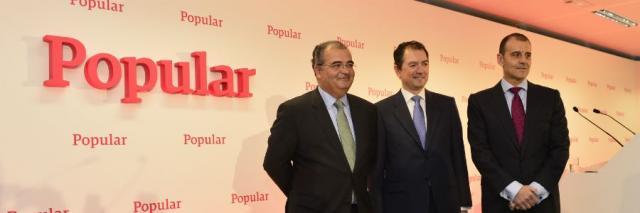À esquerda, Ángel, Ron, presidente do Banco Popular