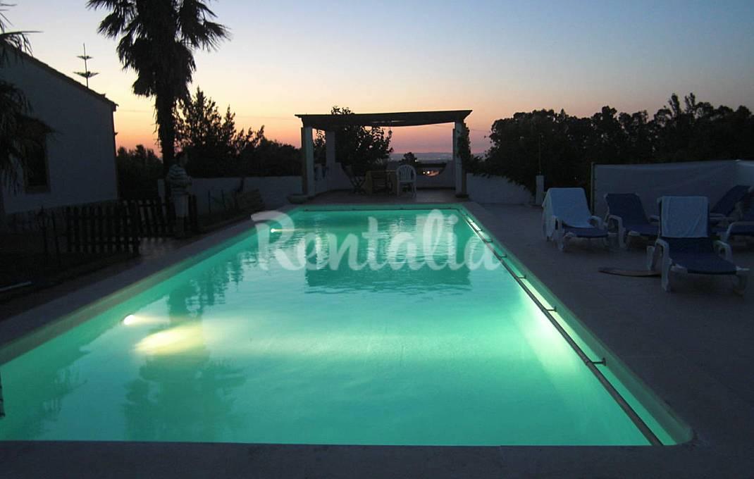 Casas de fim de semana: Relaxar numa vivenda com piscina e vista para a Serra da Arrábida