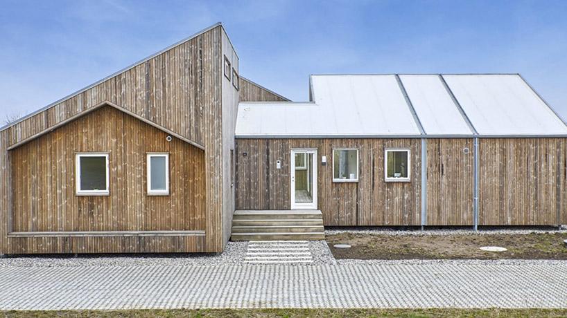 Trata-se de uma casa modular feita a partir de materiais reciclados