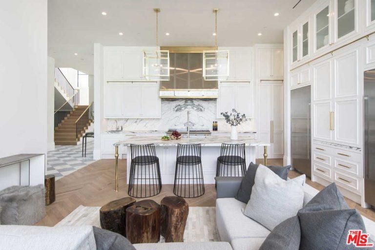 A cozinha e a sala de estar num espaço partilhado...