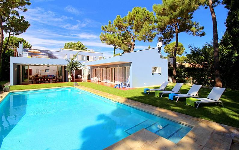 Casa de férias com piscina em Troia