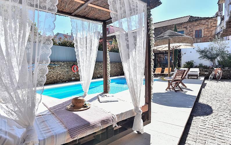 Casas com piscina para passar férias em Armamar